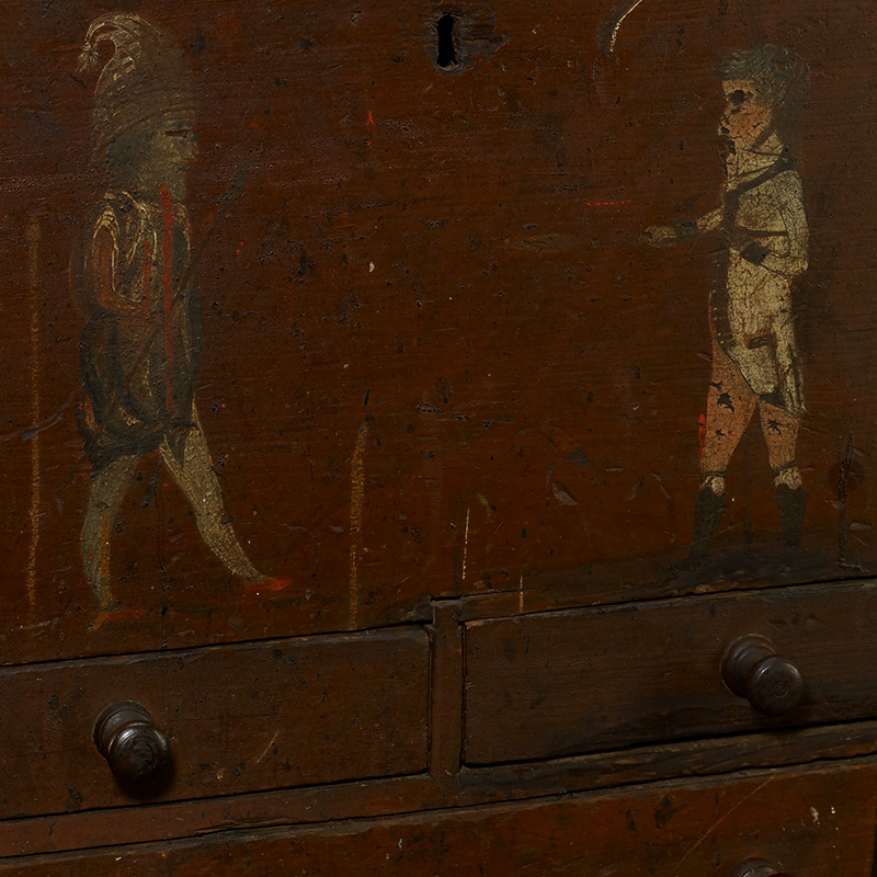 "paint decorated tool chest, featuring figure decoration of a foreign soldier and an American gentleman; lift top with a straight edge, joined to the case by applied shaped cleats, over a straight sided case with two small pull out drawers over a single long pull out drawer; drawers each feature applied turned wood knobs and are divided in the interior; box is covered with a red painted ground, with the front featuring the image of two men facing each other; man on the left is dressed in elaborate costume, including a tall plaid cap with a tassel, a multicolored shirt, white stocking, red shoes and holding a long lance; man on the right is shown in a white coat with red facings, light coral colored breeches and brown knee stockings; man is shown holding a sword in his right hand, pointed in the direction of the soldier; left side of the case is labeled in yellow lettering, ""Brads"", and the reverse features the yellow and black painted inscription, ""Eleazer Daniels, Cabinet-maker Shop""; shop inscription is painted over a figure of an officer wearing a chapeaux-de-bras"