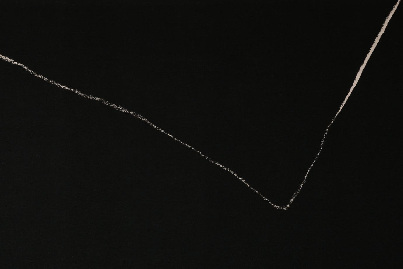 black ground; white V-shaped element on top half